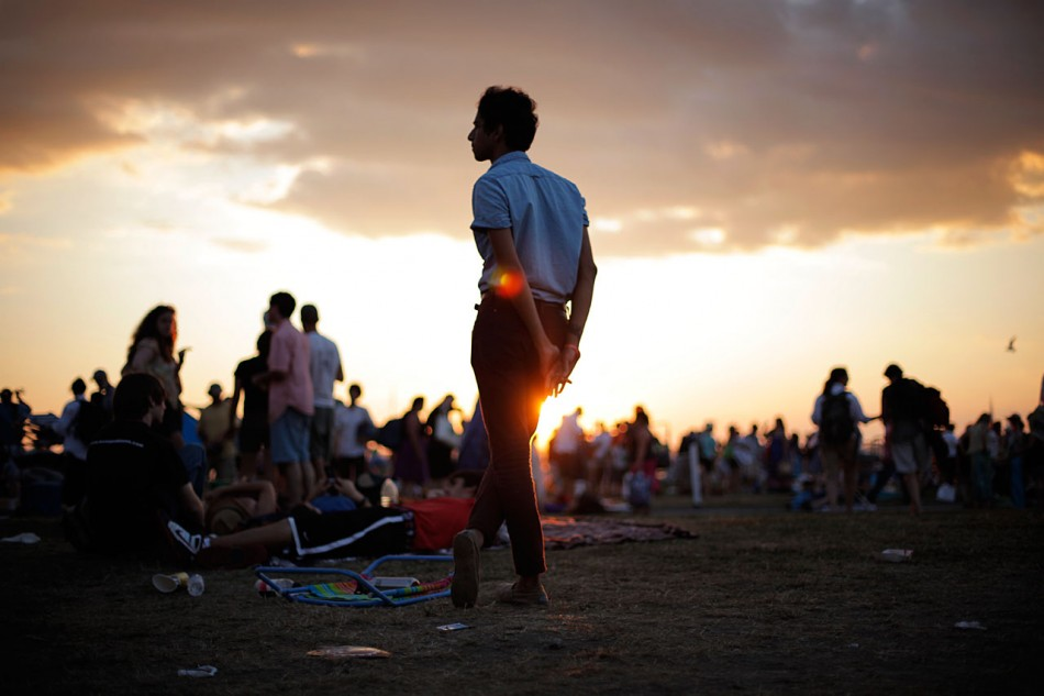 A boy silhouetted against the setting sun at Newport Folk Festival.